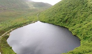Aerial shots of a Mountain Lake in Ireland