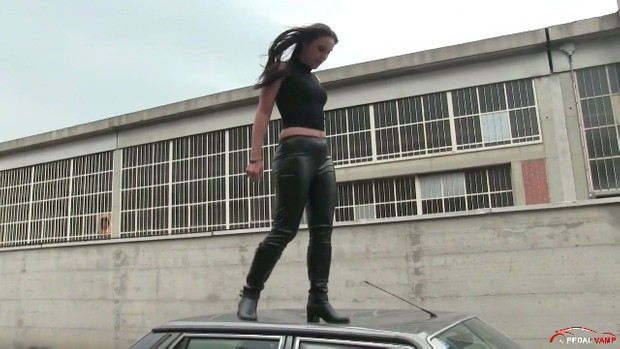 188 :   Miss Iris jumping and stomping on the hood and roof of the Lancia Prisma