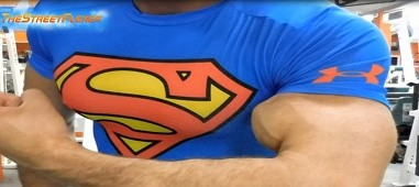 Musclegod in superman shirt flexing
