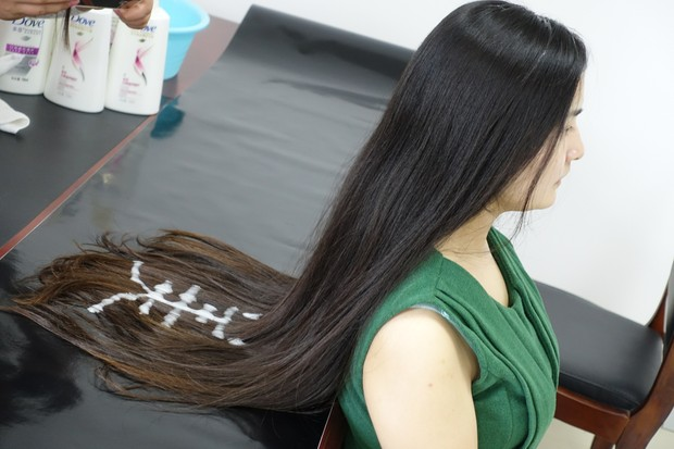 longhair writing with shampoo