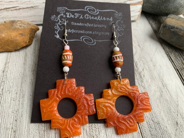 Translucent Orange Aztec Clay Dangling Earrings