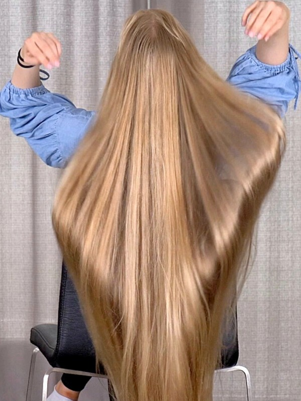 VIDEO - Heavy blonde hair lifting and dropping