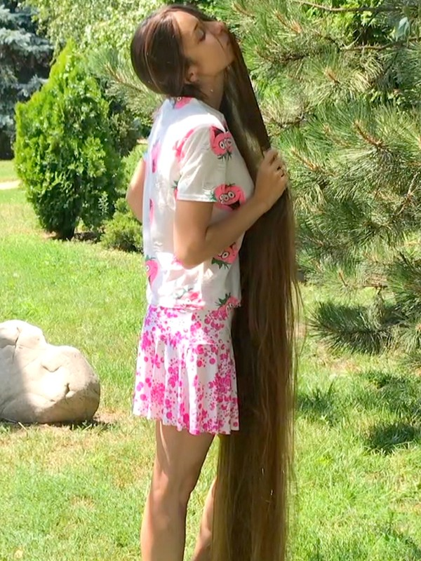 Real-Life Rapunzel's hair play and hair wrapping outside