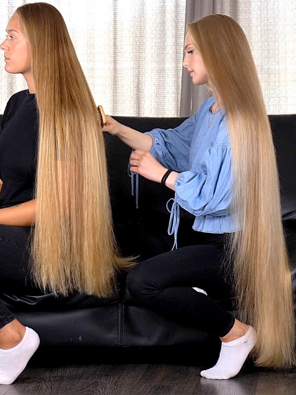 VIDEO - A long hair lady having her hair brushed by Rapunzel