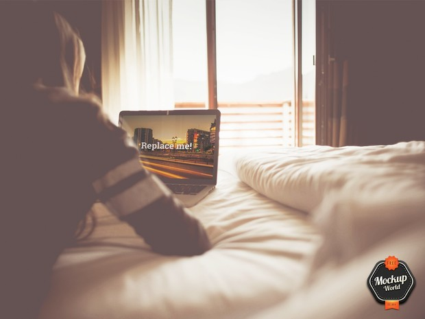 Woman working on MacBook in Bed Mockup (PSD)