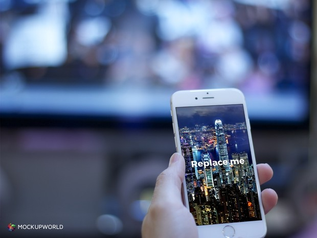 iPhone in front of TV Mockup (PSD)