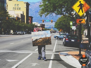 Guy holding Sign Mockup (PSD)