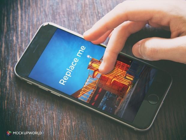 iPhone and Hand Closeup Mockup (PSD)