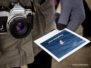 Polaroid in Hand Mockup (PSD)