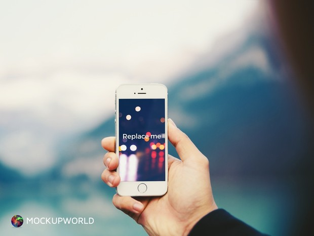 iPhone in hand Mockup (PSD)