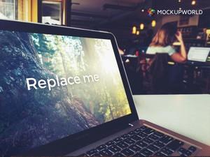 MacBook in Café Mockup (PSD)