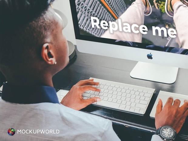 Man Working on iMac Mockup (PSD)