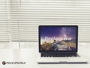 MacBook in white Room Mockup (PSD)