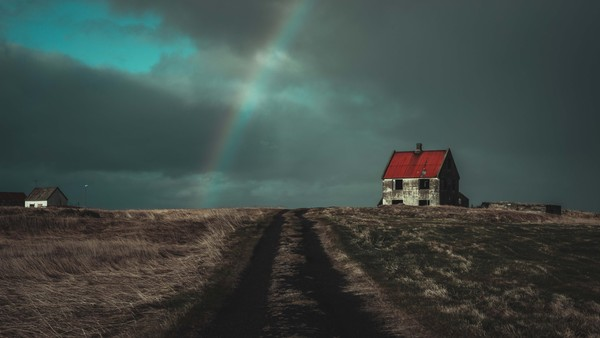 Abandoned house and a rainbow