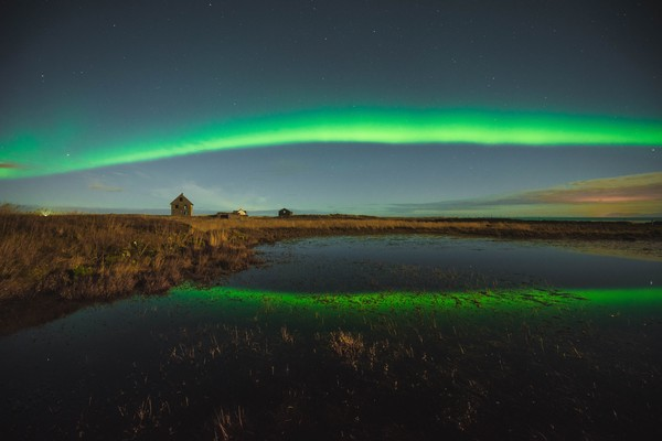 Northern lights over an abandoned house