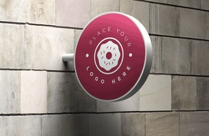 FREE WALL SIGN MOCK-UP IN PHOTOSHOP