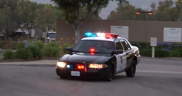 Cop car drives up Fast - close up