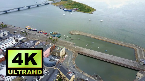 01779_aerial drone footage of a small river harbor in Ireland_4K UltraHD Version