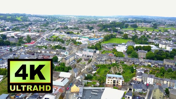 01780_aerial drone footage of small river town in Ireland_4K UltraHD Version