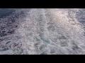 00325_GoPro Hero 4 1080p/60fps seafoam blue sea ship stern view seamless loop