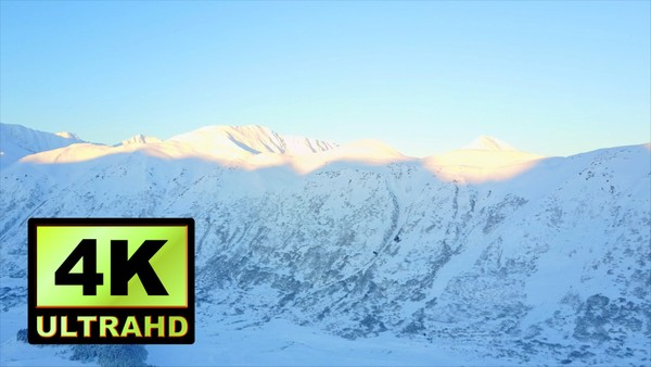 01713_aerial drone footage of a beautiful snowed mountainside in Alaska_4K UltraHD Version