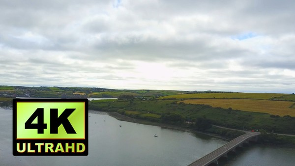 01744_aerial drone footage of river, bridge and grassland in Ireland_4K UltraHD Version