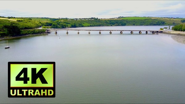 01733_aerial drone footage of beautiful river and bridge in Ireland_4K UltraHD Version