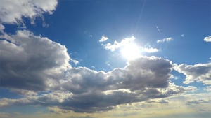 4K blue sky with clouds and sun wallpaper background
