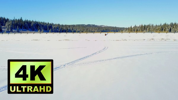 01745_aeria drone footage of frozen river and snowed bridge in Alaska_4K UltraHD Version