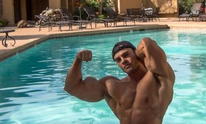 Sergio flexing by the pool